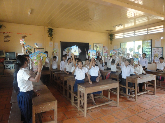 The students were happy to get hte books and pens